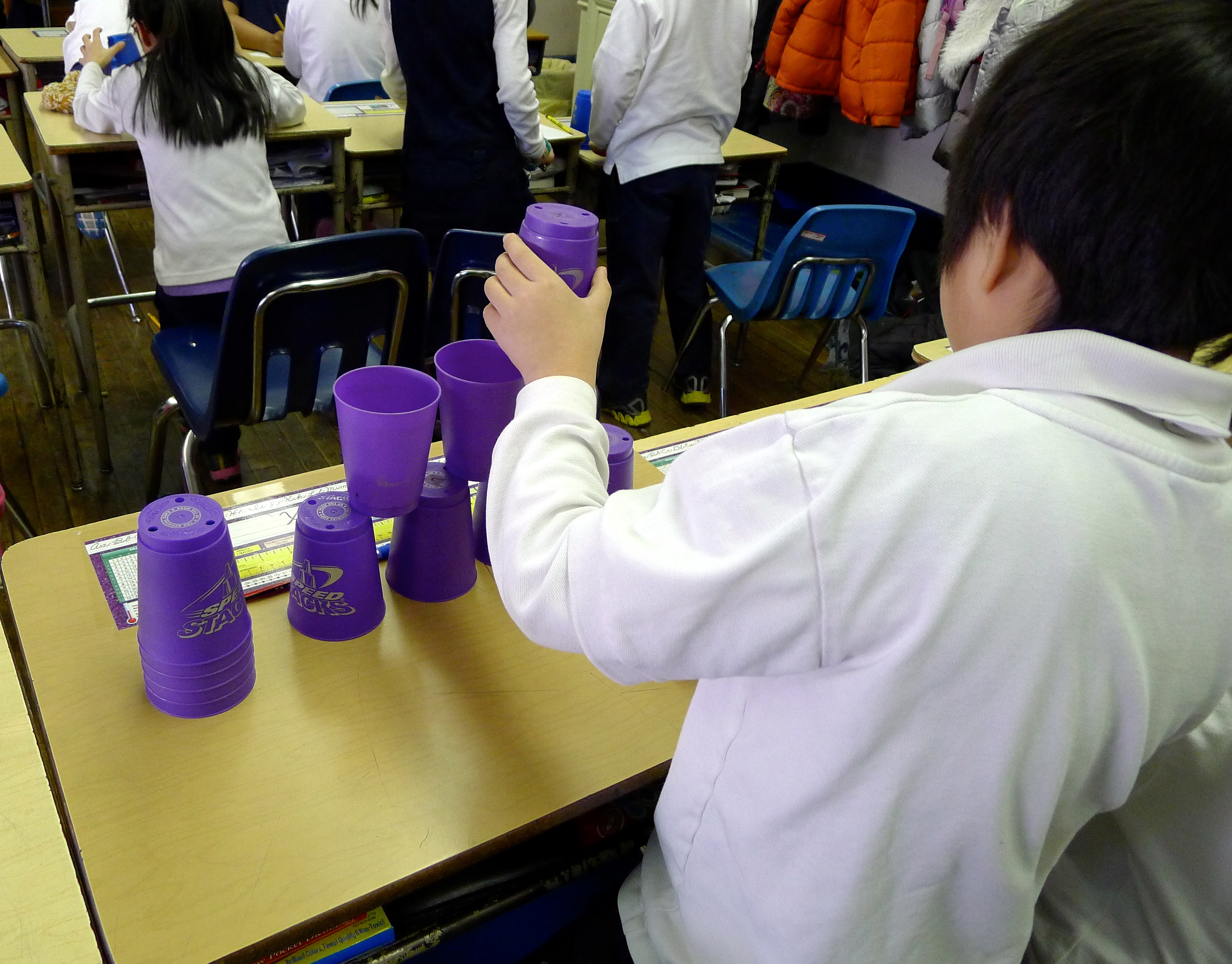 "Student ""robot"" following code to stack cups"