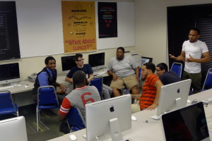 "Team, The Survival game"" discussing their concept for the game"