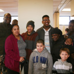 Kelvin Jeremiah with residents and Blumberg Resident Council President Pharrah Regusters